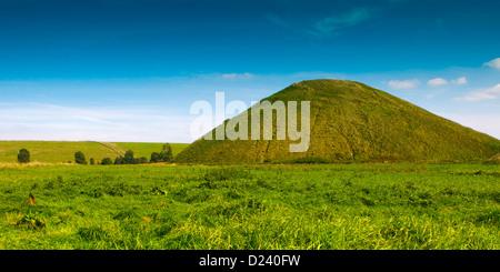 Neolithic Silbury Hill in Summer, near Avebury, Wiltshire, England, UK. - Stock Photo