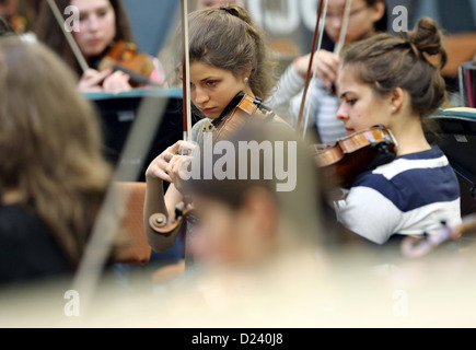 String players of the federal youth orchestra rehearse in Colditz, Germany, 7 January 2013. The principle conductor - Stock Photo
