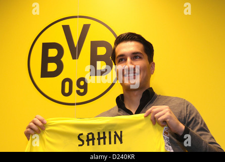 Nuri Sahin is presented as the new acquisition of Bundesliga soccer club Borussia Dortmnd (BVB) and holds up his - Stock Photo