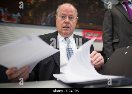 SPD chancellor candidate Peer Steinbrueck awaits the beginning of the SPD parliamentary group conference in Berlin, - Stock Photo