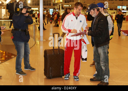 Hamburg's Rafael van der Vaart signs autographs as he returns from the team's winter camp at the airport in Hamburg, - Stock Photo