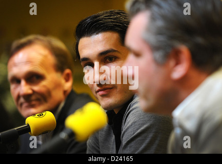 Managing director of Bundesliga soccer club Borussia Dortmnd (BVB), Hans-Joachim Watzke (L), and sporting director - Stock Photo