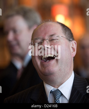 SPD chancellor candidate Peer Steinbrueck arrives for the New Year's reception of the Berliner Morgenpost newspaper - Stock Photo