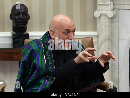 President Hamid Karzai of Afghanistan gestures during a meeting with United States President Barack Obama in the - Stock Photo
