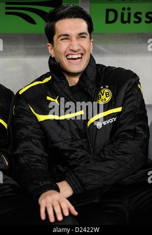 Dortmund's Nuri Sahin smiles prior to the soccer WinterCup semi final match Fortuna Duesseldorf vs Borussia Dormund - Stock Photo
