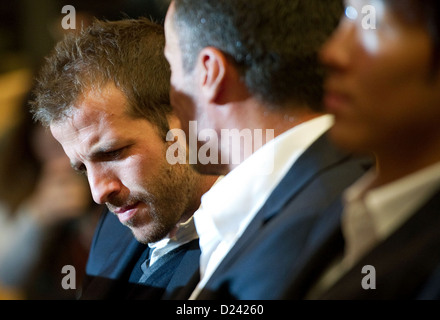 Hamburg's Rafael van der Vaart (L) sits among some of his teammates during the Hamburger SV's (HSV) general assembly - Stock Photo