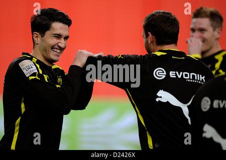 Dortmund's Nuri Sahin (L) smiles prior to the soccer WinterCup semi final match Fortuna Duesseldorf vs Borussia - Stock Photo