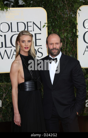 Actor Jason Statham and model Rosie Huntington-Whiteley arrive at the 70th Annual Golden Globe Awards presented - Stock Photo