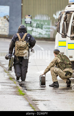 Belfast, Northern Ireland, UK. 14th January 2013.   Army ATO from 321 Squadron, 11 EOD Regiment, dressed in a bomb - Stock Photo