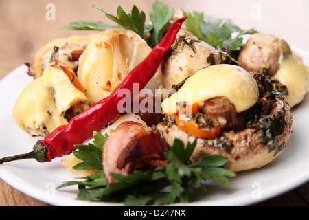 the mushrooms baked with potatoes and bacon - Stock Photo