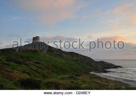 Spanish tower in San Giovanni di Sinis, Sardinia, italy - Stock Photo