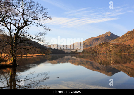 View to Yr Aran with reflections in still tranquil waters of Llyn Gwynant lake in mountains of Snowdonia National Park landscape. North Wales UK