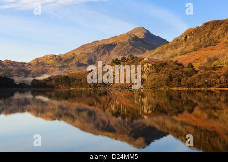 Yr Aran mountain reflected in still water of Llyn Gwynant lake in mountains of Snowdonia National Park Nantgwynant North Wales UK Britain