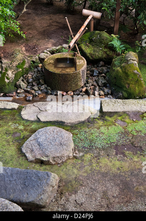 Ryoan-ji Temple, Kyoto, Japan. A tsukubai or water basin for ritual washing or purification - Stock Photo