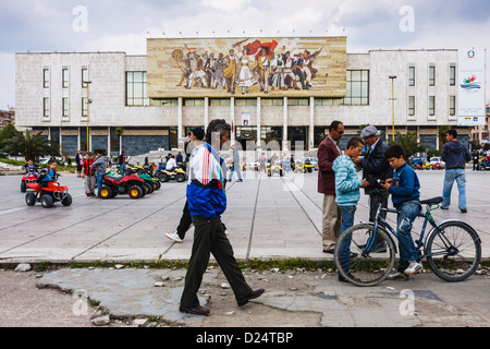 People at Skanderbeg Square next to National History Museum. Tirana, Albania - Stock Photo