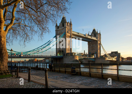 Tower Bridge in late afternoon light viewed from North side of river Thames and tower of London. - Stock Photo