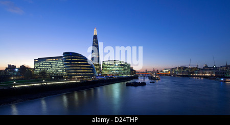 View down the Thames along south bank showing the The Shard building GLC and modern office blocks, Southwark, London, - Stock Photo