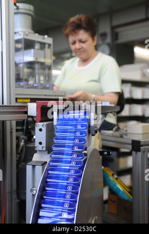Schwyz, Switzerland, a woman wrapped finished pocket knife Victorinox - Stock Photo
