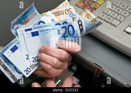 Berlin, Germany, money is taken out of the cash register - Stock Photo