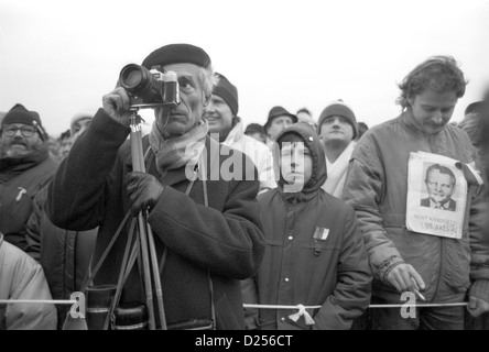 November 1989 Velvet Revolution. Photographer at Letna Stadium photographing Alexander Dubcek during his address. - Stock Photo