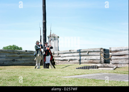 Fort Stanwix reenactors: American Continental Artillery soldier holding musket behind fort walls. - Stock Photo