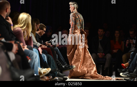 The model Lexy Hell presents a creation at the 'Kauffeld Jahn Couture' show during the fashion week in Berlin Germany, - Stock Photo