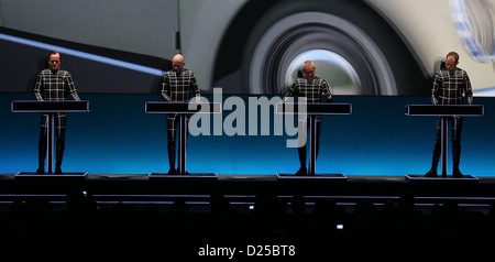 The members of the German electronic band Kraftwerk perform on stage at the arts exhibition venue 'Kunstsammlung - Stock Photo