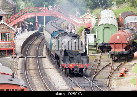 Steam locomotive pulling a passenger train on the North Yorkshire Moors Railway  at Goathland - Stock Photo