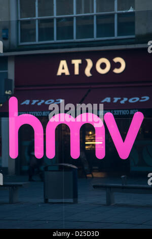 Bristol, UK. 15th January 2013. Reflection of other high street favourite, Costa, in the window of HMV Credit:  - Stock Photo