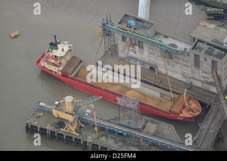 Aerial photograph of a ship being loaded with sand - Stock Photo