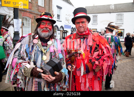 Red Leicester Morris dancers in costume, Whittlesey Straw Bear festival, Cambridgeshire, UK - Stock Photo