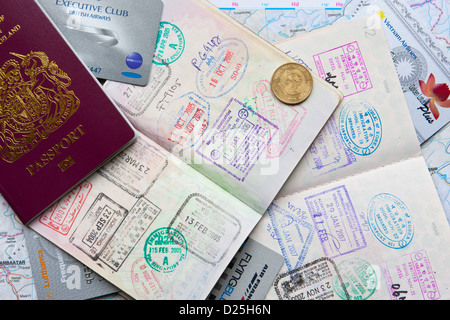 Multiple entry and exit country stamps in a Canadian and British passports also British Airways, Vietnam Airways - Stock Photo