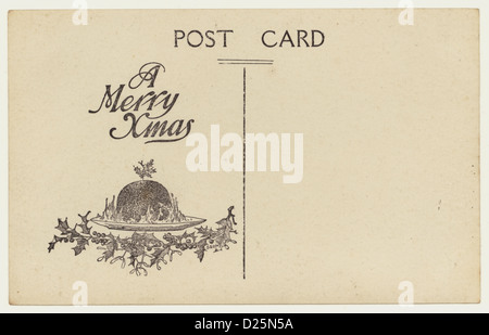 Reverse of early 1900's postcard with the motif 'A Merry Xmas' - Stock Photo