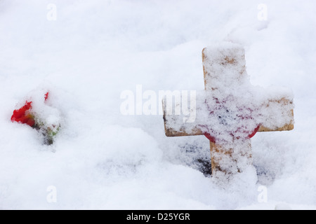Remembrance Cross With Poppy In The Snow - Stock Photo