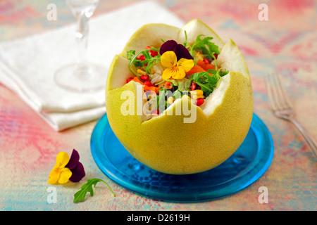 Stuffed grapefruit with salad. - Stock Photo