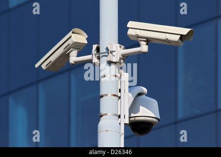 three cctv security cameras on street pylon - Stock Photo