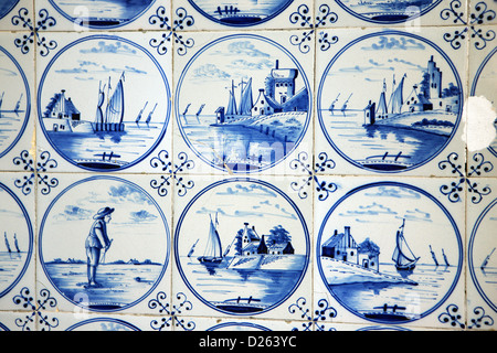 Dutch blue and white Delftware tiles at the entrance to a building in Amsterdam - Stock Photo
