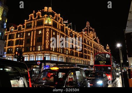 Facade of Harrods store at night - Stock Photo