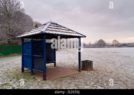 A cold snow covered shelter in an empty public park in winter, Nottinghamshire, England, UK - Stock Photo