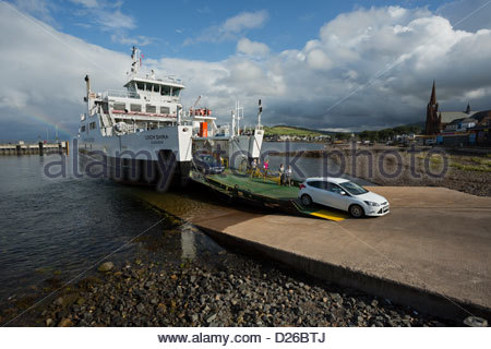 Cars and passengers departing the Caledonian MacBrayne Ferry,  the MV Loch Shira, on the slip at Largs, Ayrshire - Stock Photo