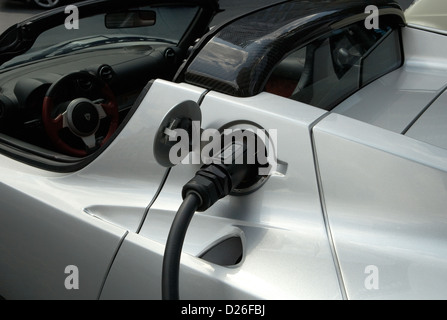 Berlin, Germany, a Tesla Roadster is charged - Stock Photo