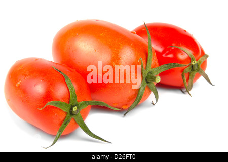 Three Red tomatoes vegetable isolated on white background - Stock Photo