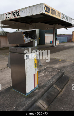 Broken petrol pump in abandoned, derelict filling station, closed for business. - Stock Photo