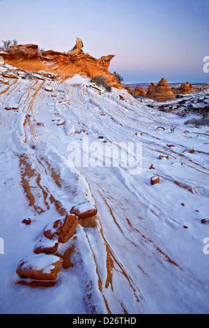 Snow on rock formations in Coyote Buttes - Stock Photo