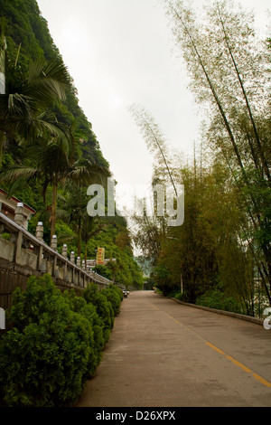 A road by the Li River in Yangshuo town in Southern China. - Stock Photo