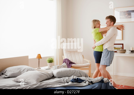 Couple dancing in bedroom   Stock Photo. Young Couple Dancing In Bedroom Stock Photo  Royalty Free Image