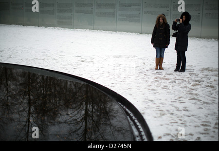 Visitors walk through the snow-covered memorial to the murdered Sinti and Roma by the Nazis in Berlin, Germany, - Stock Photo