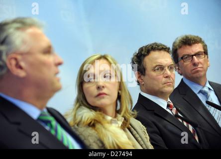 Bavarian Interior Minister Joachim Herrmann (L-R), Justice Minister Beate Merk, Federal InteriorMinister Hans-Peter - Stock Photo