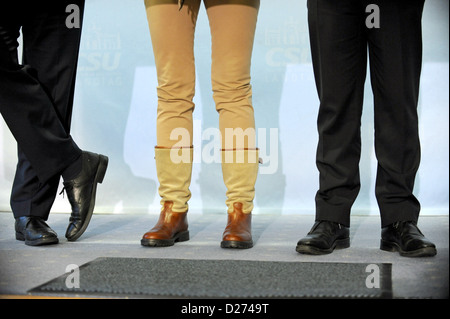 The legs of Bavarian Interior Minister Joachim Herrmann (L-R), Justice Minister Beate Merk and Federal Interior Minister - Stock Photo