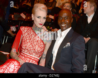 German Tattoo-Girl Lexy Hell and US choreographer Bruce Darnell attend at the Lena Hoschek show during the Mercedes - Stock Photo